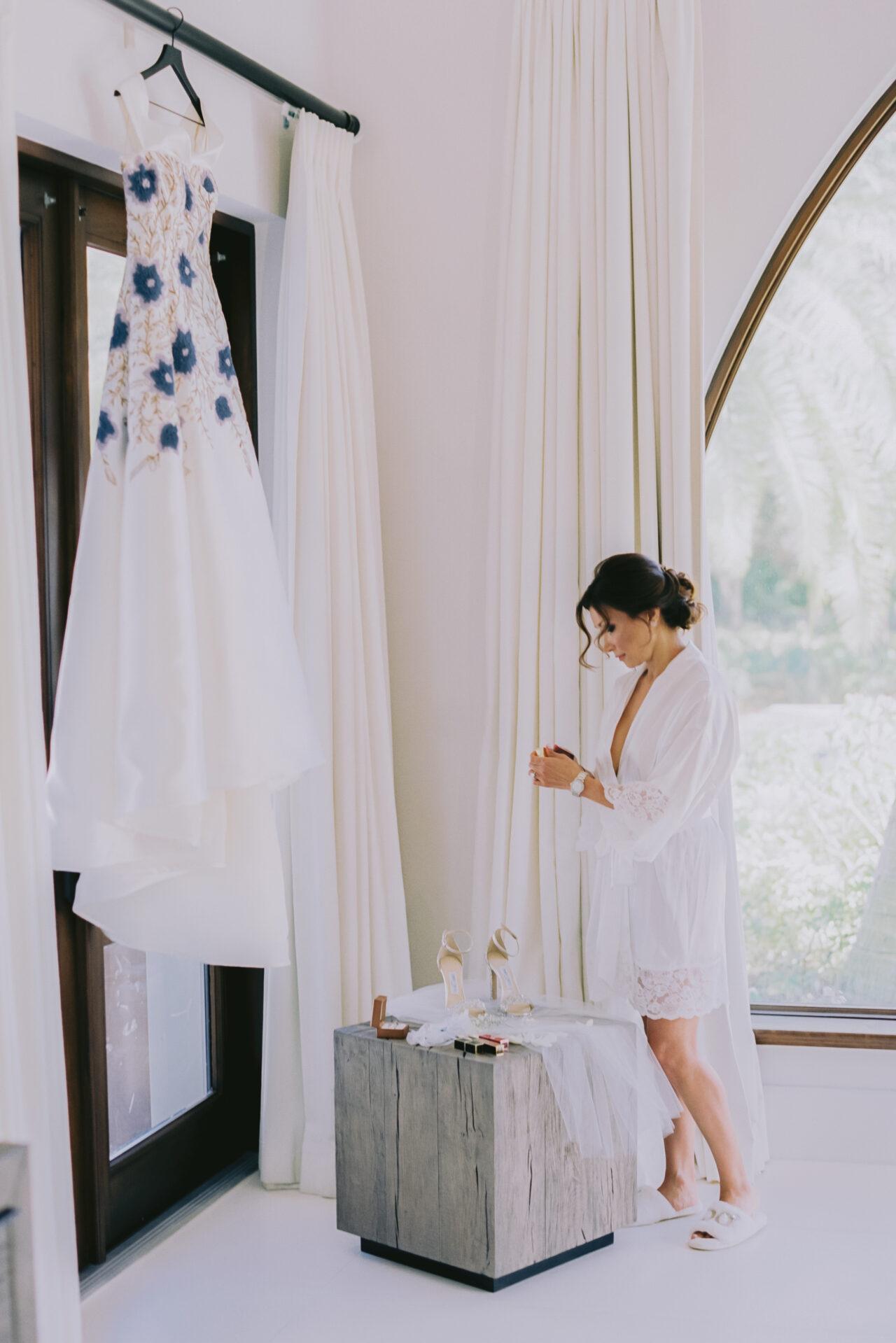 bride in front of her luxury wedding dress